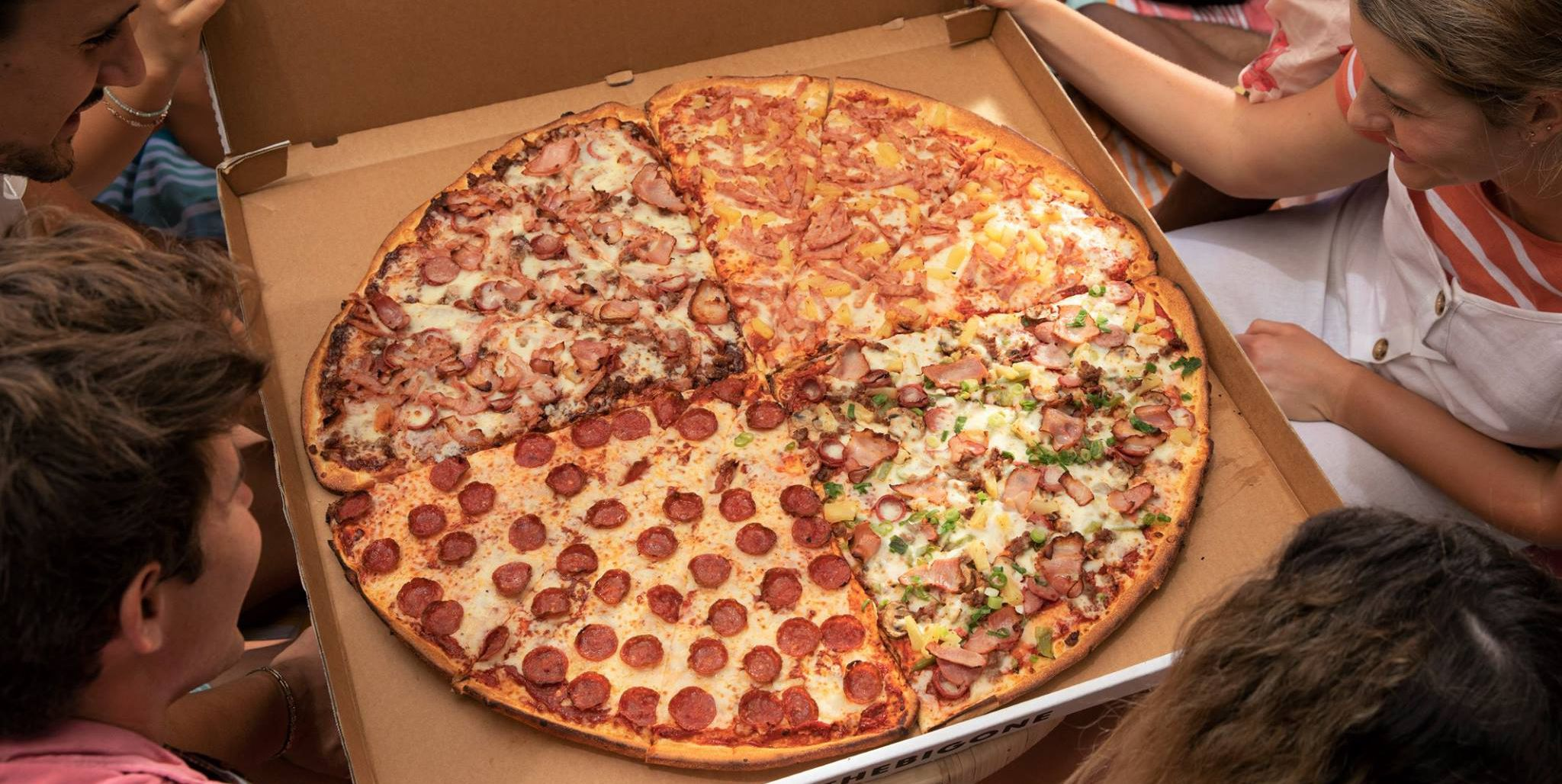 Domino's Is Selling Its Biggest Pizza Ever, and It Barely Can Fit into Cars