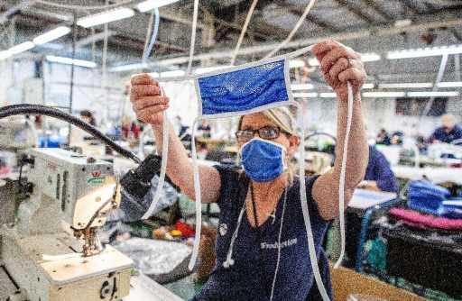 Northern Ireland sportswear factory scrubs up in virus fight