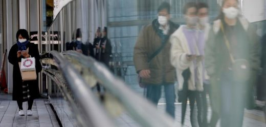 Japan finds new COVID-19 strain, while immigration centre reports infections